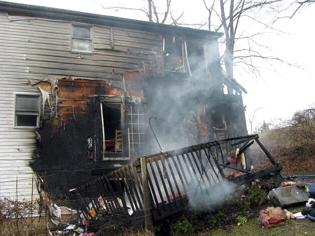 A fire damaged a home on Reservoir Street in Bethel, Conn. Thursday, March 7, 2013. Photo credit: Rob Fish Photo: Contributed Photo / The News-Times Contributed