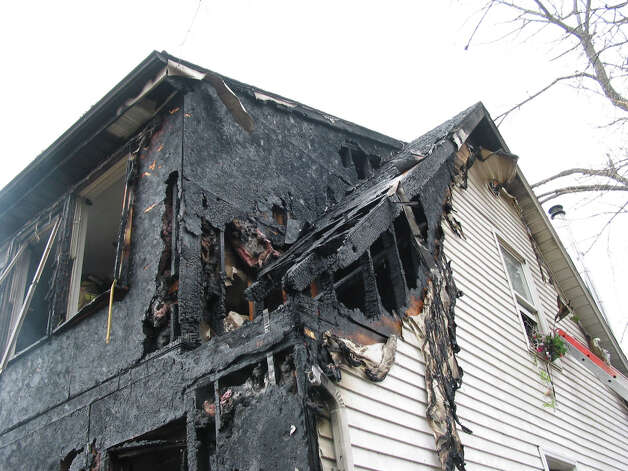 A fire damaged a home on Reservoir Street in Bethel, Conn. Thursday, March 7, 2013. Photo credit: Rob Fish Photo: Contributed Photo/ Rob Fish, Contributed Photo / The News-Times Contributed