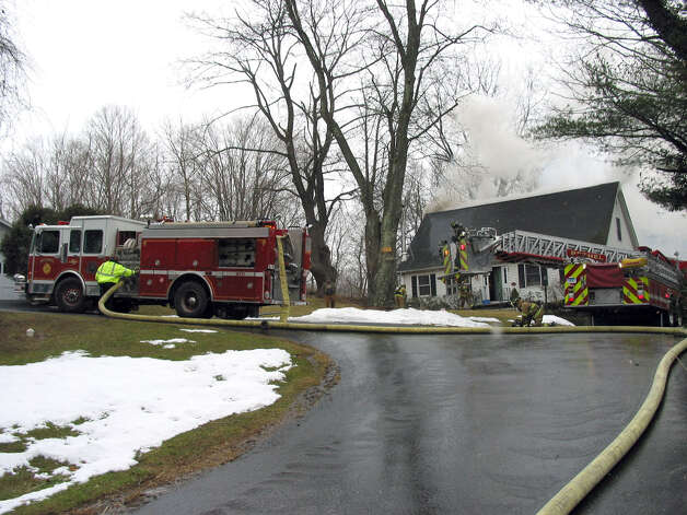 A fire damaged a home on Reservoir Street in Bethel, Conn. Thursday, March 7, 2013. Photo: Contributed Photo