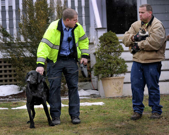Bethel Animal Control Officer Steven Shanley, left, and Chris McCollom, with the Bethel Fire Dept. tend to animals that were removed from a house fire on Reservoir Street in Bethel, Conn. Thursday, March 7, 2013. Photo: Carol Kaliff / The News-Times