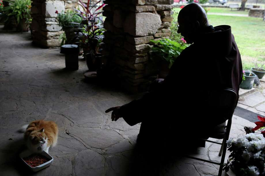 Brother Jerome Wolnick talks to Moses, one of two cats in his care, at Mission Espada on Wednesday, Feb. 20, 2013. Photo: Lisa Krantz, San Antonio Express-News / San Antonio Express-News