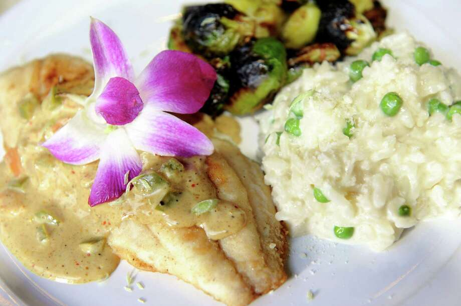 The Lent Special: red snapper with curry bechamel served with sweet pea risotto and charred brussel sprouts with duck bacon on Tuesday, March 5, 2013, at Carney's Tavern in Ballston Lake, N.Y. (Cindy Schultz / Times Union) Photo: Cindy Schultz / 10021397A