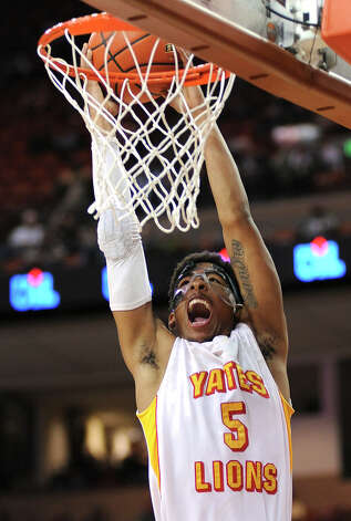 Yates' JC Washington (5) dunks the ball during the UIL 3A semi final boys basketball game between Houston Yates and Royal high schools on Thurs., March 7, 2013 at the Frank Erwin Center in Austin, TX.
