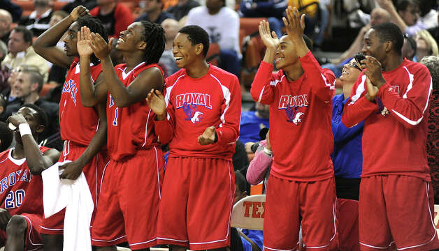 Royal celebrates from the side line during the UIL 3A semi final boys basketball game between Houston Yates and Royal high schools on Thurs., March 7, 2013 at the Frank Erwin Center in Austin, TX.