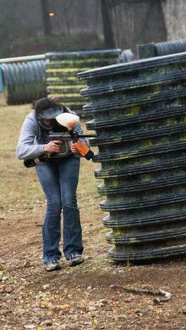 Amber Call, 18, of San Antonio, takes aim at the other team during a paintball match. Photo by Joshua Trudell//Special to the Express-News