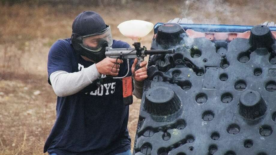 Phillip Call takes aim at the other team during a paintball match. Photo by Joshua Trudell//Special to the Express-News