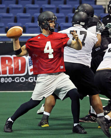 Carlton Brown throws a pass as the SanAntonio Talons host a media day at the Alamodome on March 7, 2013. Photo: TOM REEL, Express-News
