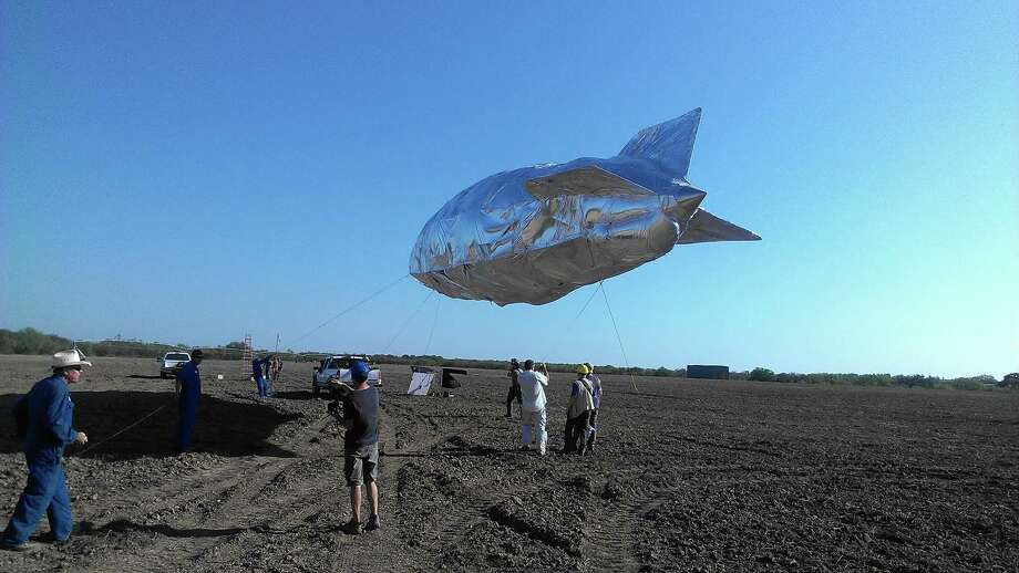 A model of the Hindenburg dirigible, seen in a 2012 photo taken by Southwest Research Institute's Director of Fire and Technology Matthew Blais, is moored before a test attempting to determine the cause of the famous 1937 explosion. Photo: Matthew Blais / Photo courtesy of the Southwest Research Institute