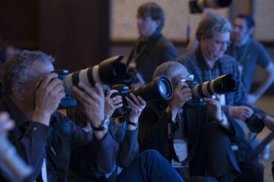 Photographers take pictures of Bob Dudley, group chief executive at BP, as he spoke at IHS CERAWeek 2013 at the Hilton Americas Wednesday, March 6, 2013, in Houston.