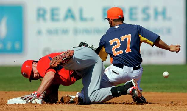 Corey Brown, left, slides into second with a double as Astros second baseman Jose Altuve loses the ball during the third inning. Photo: David J. Phillip