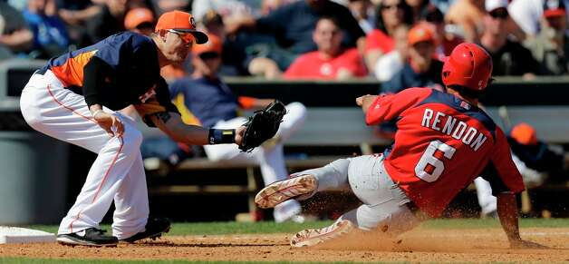 Anthony Rendon is tagged out by Astros shortstop Tyler Greene, left, while trying to advance from second to third on a ball hit to the infield by Tyler Moore during the fifth inning. Photo: David J. Phillip