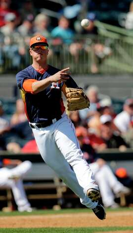 Astros third baseman Matt Dominguez throws to first after fielding a ground ball hit by the Nationals' Tyler Moore during the fifth inning. Photo: David J. Phillip