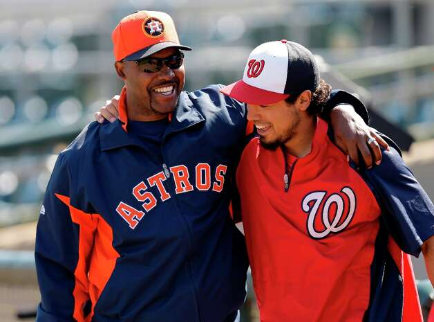 Astros manager Bo Porter, right, talks with Nationals infielder Anthony Rendon, right, before the game. Photo: David J. Phillip