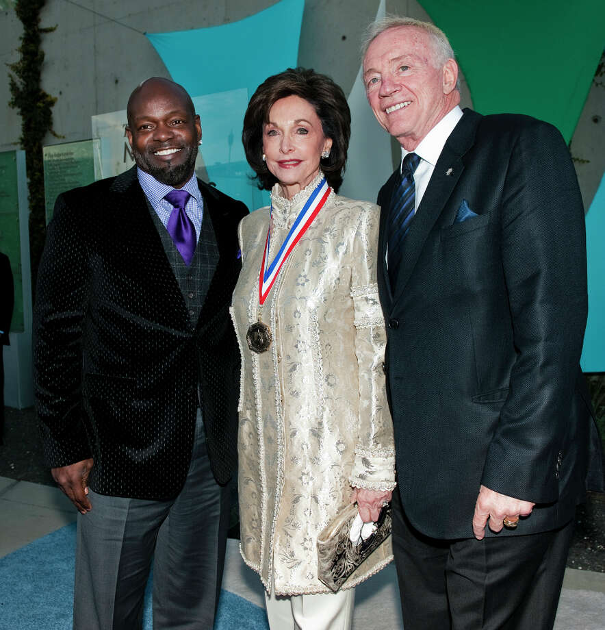 Retired NFL runningback Emmitt Smith, left, honoree Gene Jones, center, and Cowboys owner Jerry Jones, left, on the red carpet of the 2013 Texas Medal of Arts gala on Tues., March 5, 2013 at the Long Center in Austin, TX.  Gene Jones and her daughter, Charlotte Jones Anderson, received the Indiviual Art Patron Award.Ashley Landis for the Houston Chronicle Photo: Ashley Landis, For The Houston Chronicle / copyright 2013 Ashley Landis