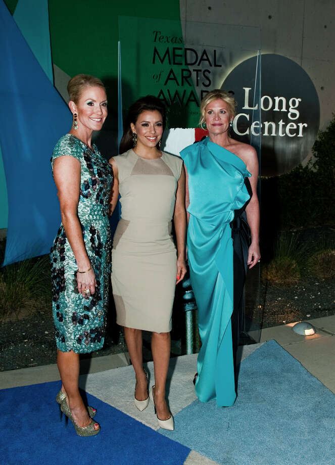 Actress Eva Longoria, center, with Texas Medal of Arts co-chairs Marita Fairbanks, left, and Kelli Blanton, right, on the red carpet of the 2013 Texas Medal of Arts gala on Tues., March 5, 2013 at the Long Center in Austin, TX.  Longoria received the Multimedia Award.Ashley Landis for the Houston Chronicle Photo: Ashley Landis, For The Houston Chronicle / copyright 2013 Ashley Landis
