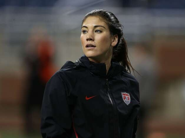 Hope Solo of Team USA warms up prior to the start of the game against China at Ford Field on December 8, 2012, in Detroit, Michigan. USA defeated China 2-0.