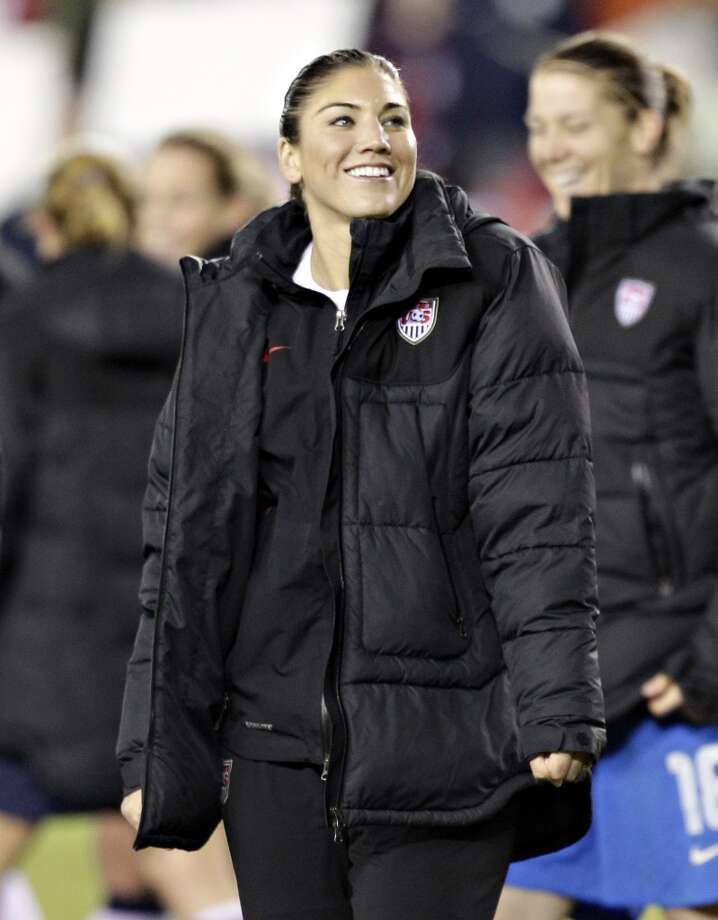 Hope Solo leads her team off the field after defeating China at BBVA Compass Stadium on December 12, 2012, in Houston, Texas. USA won 4-0.