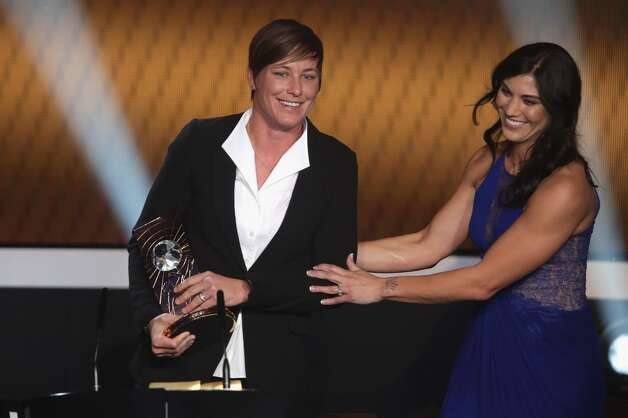 Abby Wambach, left, of United States receives her FIFA womens player of the year trophy as Hope Solo looks on during the FIFA Ballon d'Or Gala 2013 at Congress House on January 07, 2013, in Zurich, Switzerland.