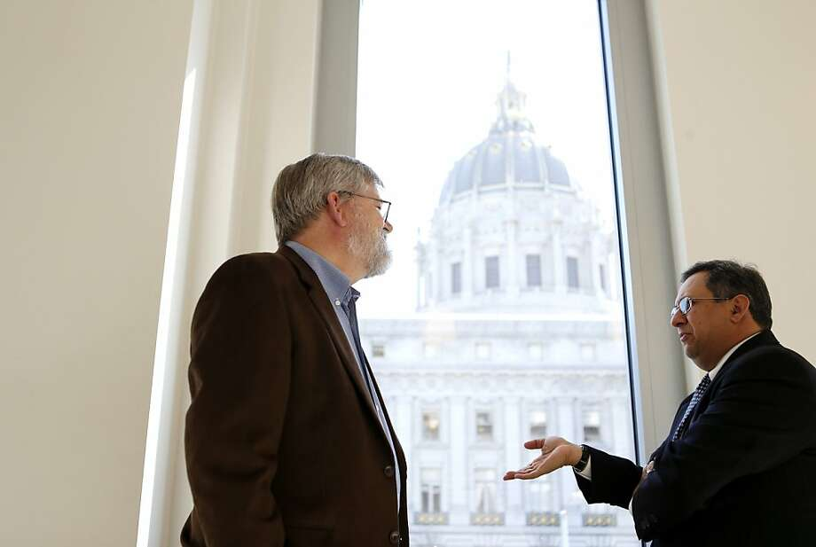 Philip Brouwer (right) of Los Gatos, a claimant in a lawsuit against Blue Shield, talks with attorney Alan Mansfield. Photo: Beck Diefenbach, Special To The Chronicle