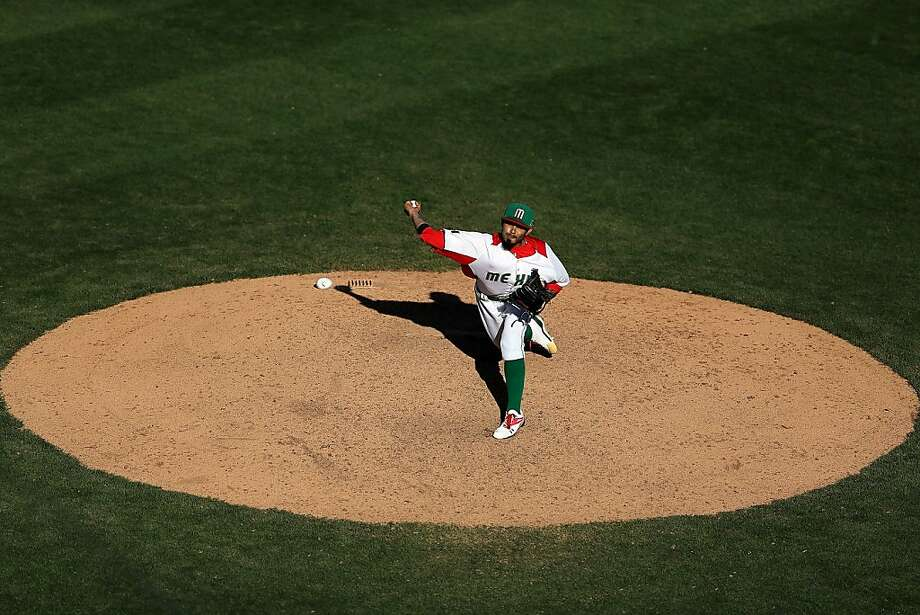 When Sergio Romo last tried for a save, he ended the World Series. Thursday's World Baseball Classic game didn't go as well. Photo: Christian Petersen, Getty Images