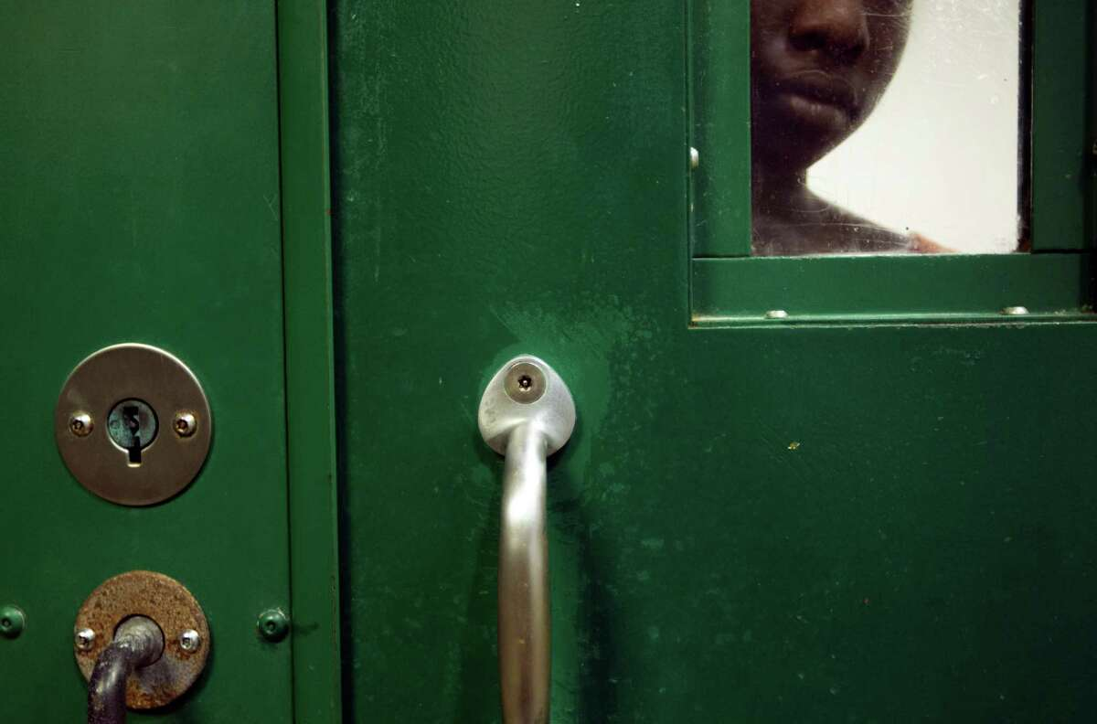 A female inmate is locked up in an acute mental health cell block at the Harris County Sheriff's Office Mental Health Unit.