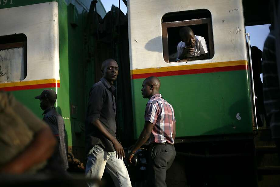 A passenger train crosses the Kibera slum of Nairobi, Kenya. Photo: Jerome Delay, Associated Press