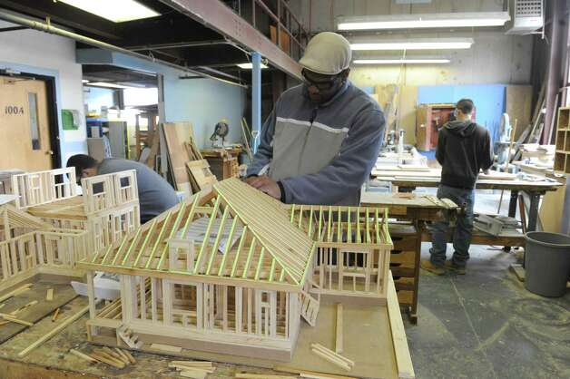 Michael Richardson of Albany works on his green model home in the building trades program at the Capital District Education Opportunity Center on Thursday March 7, 2013 in Troy, N.Y. (Michael P. Farrell/Times Union) Photo: Michael P. Farrell