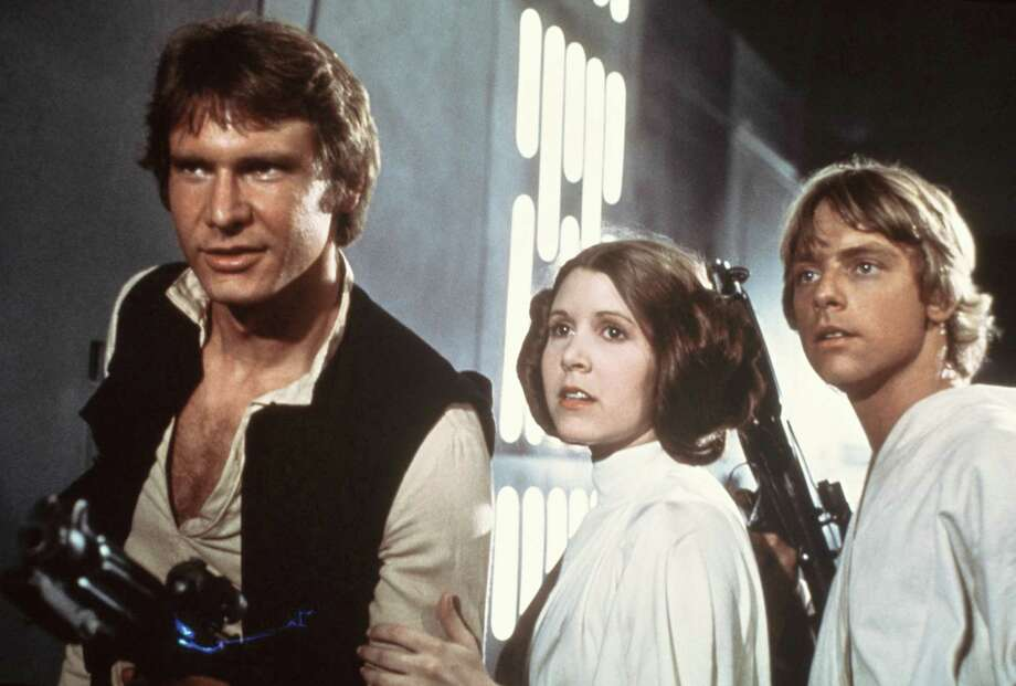 "Harrison Ford, Carrie Fisher, and Mark Hamill in a scene from ""Star Wars."" Photo: Anonymous, HOEP / 20th Century-Fox Film Corporatio"