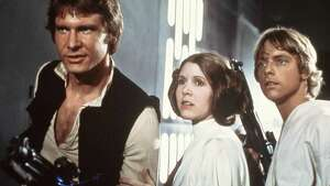 "FILE - This 1977 file image provided by 20th Century-Fox Film Corporation ahows, from left, Harrison Ford, Carrie Fisher, and Mark Hamill in a scene from ""Star Wars."" Fisher says she's coming back as Princess Leia for the new ?Star Wars? films. The actress confirmed that she'll return as the iconic character in an interview posted Wednesday, March 6, 2013, with Florida's Palm Beach Illustrated. Casting for the films has yet to be announced, but Fisher answered a simple ?yes? when asked if she would be reprising Leia.  (AP Photo/20th Century-Fox Film Corporation, file)"