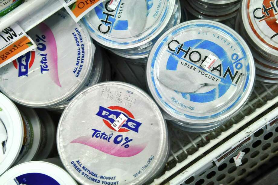 View of a display of FAGE and Chobani Greek yogurts, both products of New York State, at the Hannaford store in Latham Farms on Thursday June 9, 2011 in Latham, NY.  FAGE is made in Johnstown. ( Philip Kamrass / Times Union) Photo: Philip Kamrass / 00013490A
