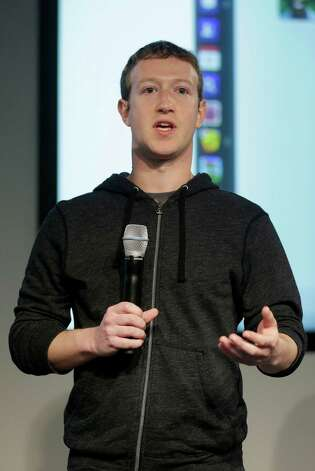 Facebook CEO Mark Zuckerberg speaks at Facebook headquarters in Menlo Park, Calif., Thursday, March 7, 2013. Zuckerberg on Thursday unveiled a new look for the social network's News Feed, the place where its 1 billion users congregate to see what's happening with their friends, family and favorite businesses. (AP Photo/Jeff Chiu) Photo: Jeff Chiu