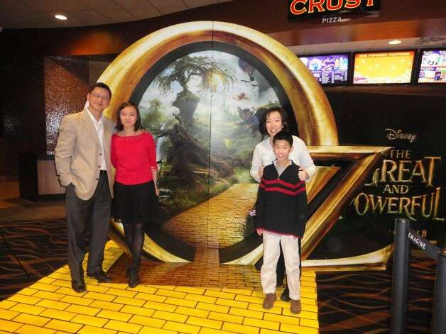 "The Lius at a screening held March 5 in Michigan for ""Oz, the Great and Powerful."" From left: Sam, Veronica, Irene and Brandon. (Courtesy Liu Family)"