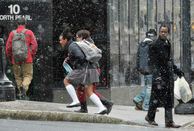 Pedestrians on State Street rush along as snow begins to fall in Albany Thursday March 7, 2013.  (John Carl D'Annibale / Times Union) Photo: John Carl D'Annibale