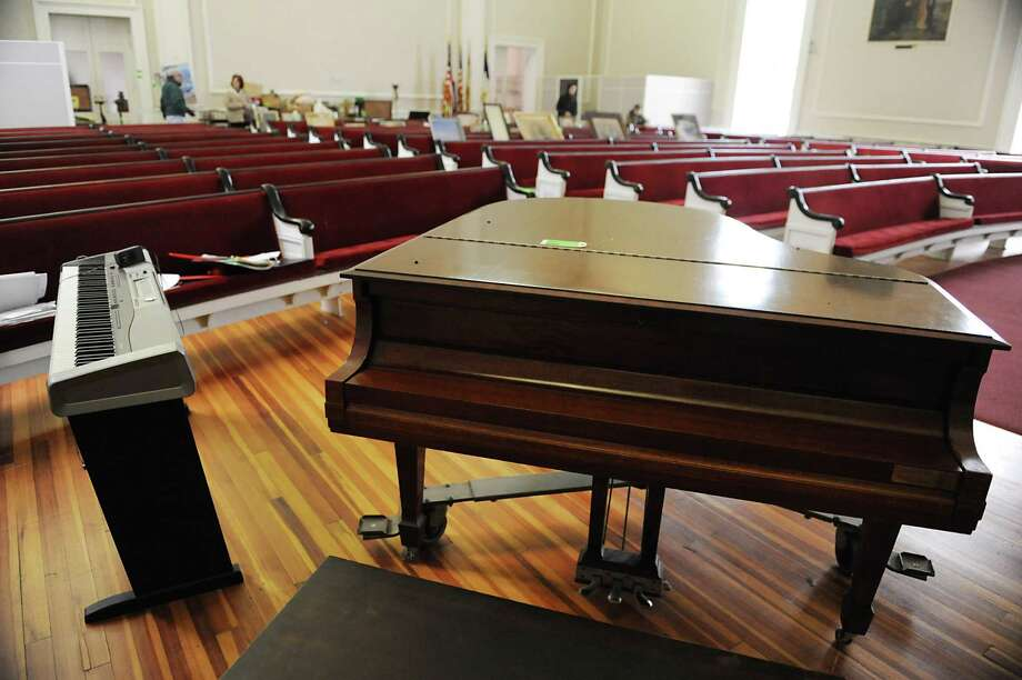 Two pianos are just a couple of the contents in the First Baptist Church to be auctioned off by Collar City Auctions on Thursday March 7, 2013 in Troy, N.Y. Uncle Sam worshipped at this church. (Lori Van Buren / Times Union) Photo: Lori Van Buren