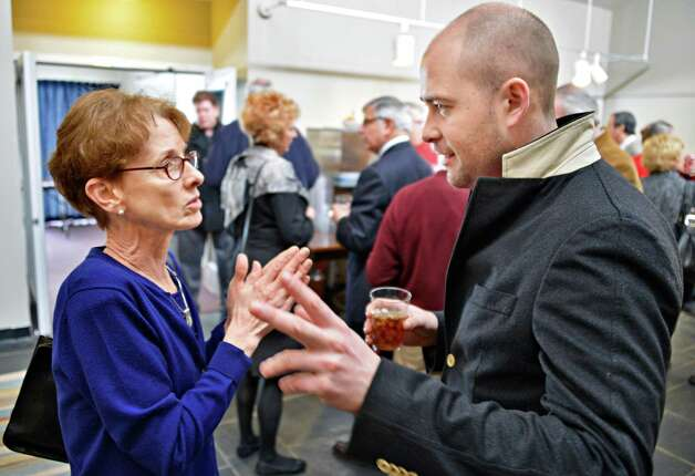 Troy City Council president Lynn Kopka, left, speaks with Peter Jenkins, the owner of the former St. Mary's church in Troy at the Conference on adaptive reuse of churches at the Carey Center in Rensselaerville Thursday March 7, 2013.   (John Carl D'Annibale / Times Union) Photo: John Carl D'Annibale / 10021434A