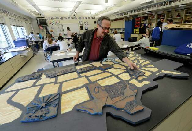 Artist Frank Giorgini, artist in residence with Shaker High School shows off his latest project of three dimensional states March 7, 2013 in Latham, N.Y.  (Skip Dickstein/Times Union) Photo: SKIP DICKSTEIN / 10021455A