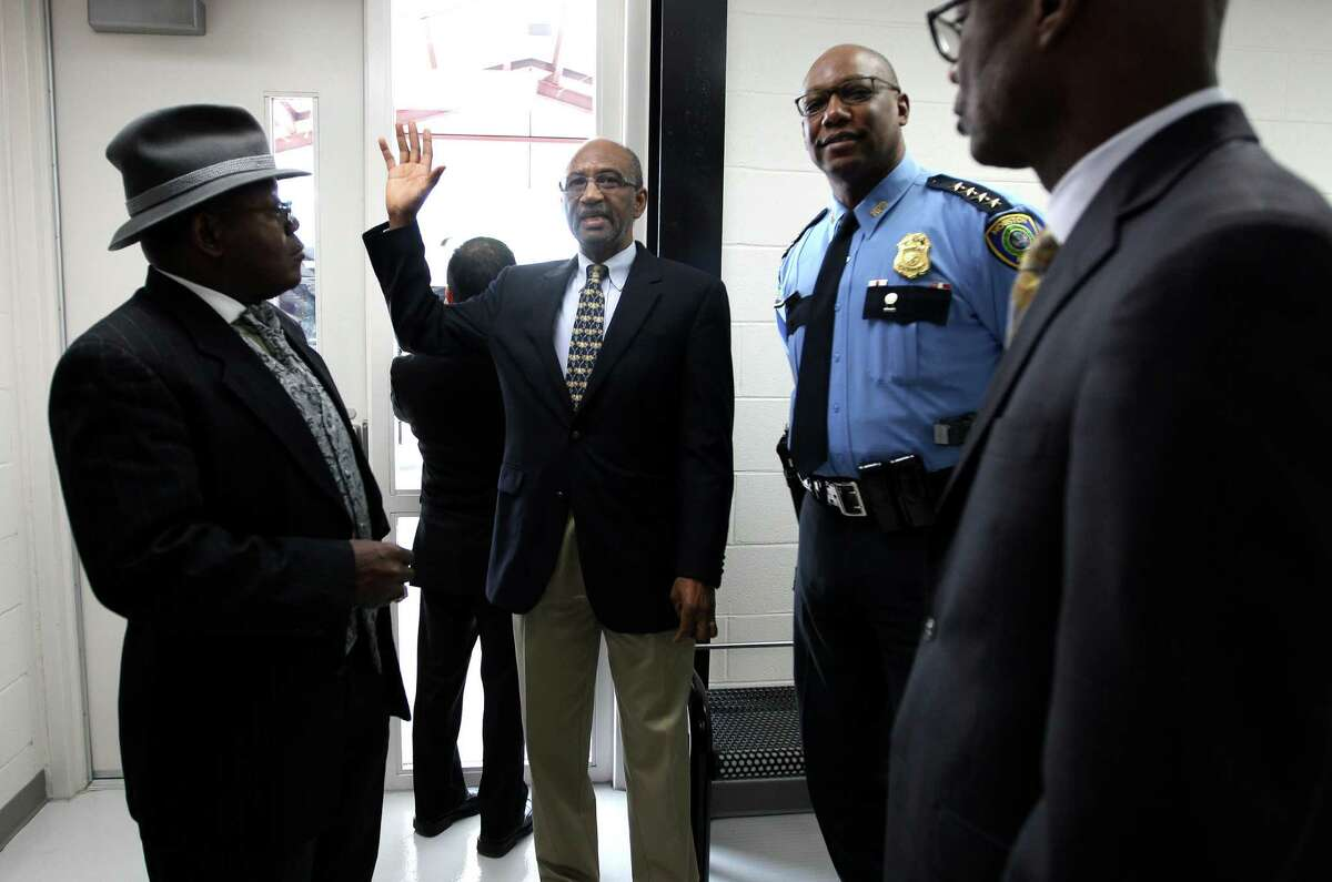 Director of the Houston Center for Sobriety, Leonard Kincaid, center, takes Houston Police Chief Charles McClelland and others on a tour of the new
