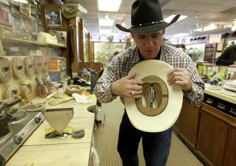 Gary Cohen, owner of The Hat Store, works on widening a hat for a customer, Wednesday, March 6, 2013, in Houston.  Cohen has sold cowboy hats to everyone from presidents, movie stars and NBA players. The Hat Store has been in business for almost 100 years, all in the same family. Photo: Karen Warren, Houston Chronicle / © 2013 Houston Chronicle