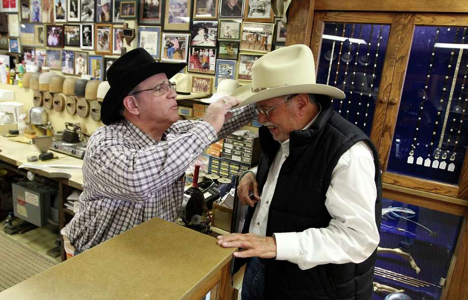 Gary Cohen, left, owner of The Hat Store, works on Tom McMahon's hat, Wednesday, March 6, 2013, in Houston. Photo: Karen Warren, Houston Chronicle / © 2013 Houston Chronicle