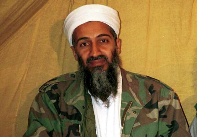"FILE - This undated file photo shows al Qaida leader Osama bin Laden in Afghanistan. Osama bin Laden's spokesman and son-in-law has been captured by U.S. intelligence officials, officials said Thursday, in what a senior congressman called a ""very significant victory"" in the ongoing fight against al-Qaida. A Jordanian security official confirmed that al-Ghaith was handed over last week to U.S. law enforcement officials under both nations' extradition treaty. He declined to disclose other details and spoke on condition of anonymity because of the sensitivity of the matter.  (AP Photo) Photo: Uncredited"