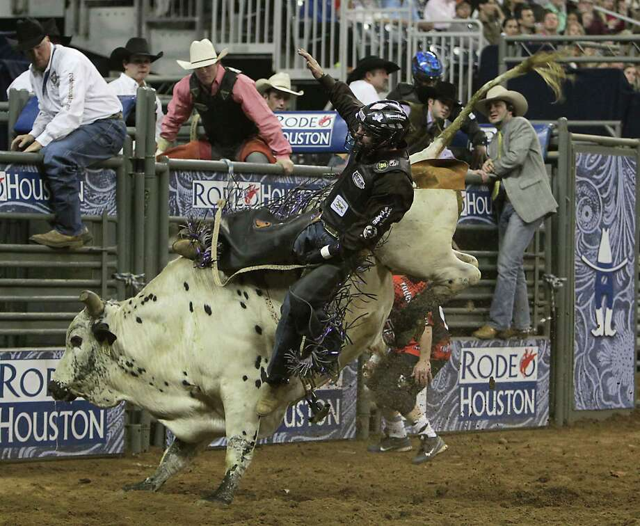 Beau Schroeder competes during the bull riding competition at RodeoHouston in Reliant Stadium Thursday, March 7, 2013, in Houston. Photo: James Nielsen, Houston Chronicle / © 2013  Houston Chronicle