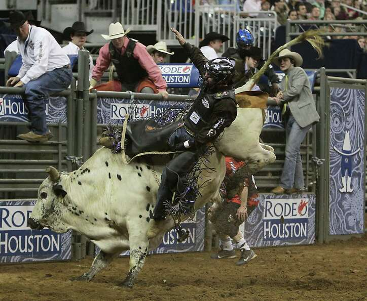 Beau Schroeder competes during the bull riding competition at RodeoHouston in Reliant Stadium Thursd