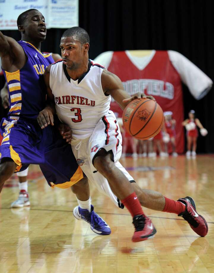 Fairfield's Derek Needham drives to the net as Albany's DJ Evans defends Saturday, Feb. 23, 2013 at the Webster Bank Arena in Bridgeport, Conn. Photo: Autumn Driscoll / Connecticut Post