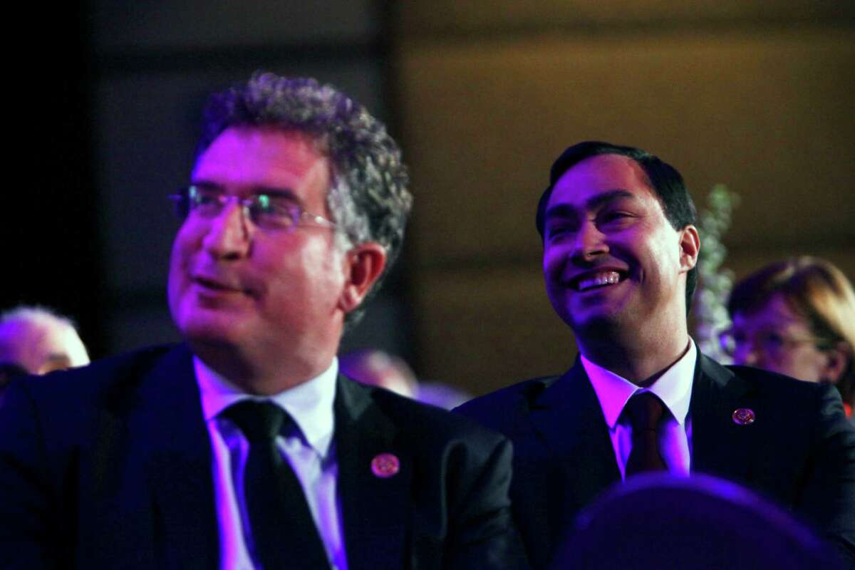 US Congressman Joe Garcia, left, smiles as San Antonio Mayor Julian Castro, not shown, recognizes his brother and US Congressman Joaqu'n Castro, right, during the mayor's keynote address at the Americans for Immigrant Justice annual meeting at the Hotel Intercontinental in Miami, Florida, on Thursday, March 7, 2013.