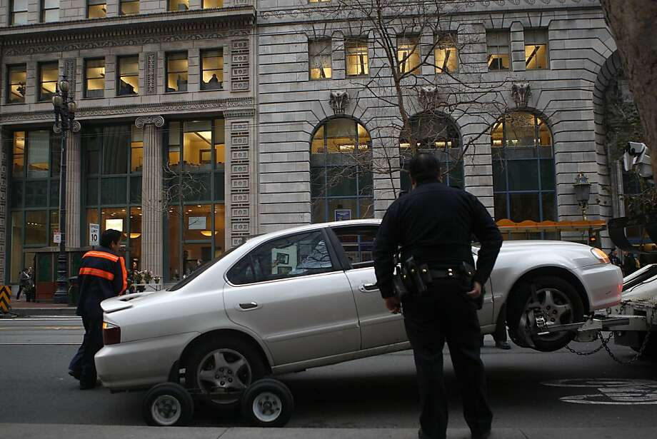Police tow a car that was involved in a shooting on Market St. in San Francisco, Calif., on Thursday, March 7, 2013. According to officials, the victim of the shooting, which occurred on Main Street at Bryant Street, was driven to Market street in the car and later picked up by an ambulance. Photo: Liz Hafalia, The Chronicle