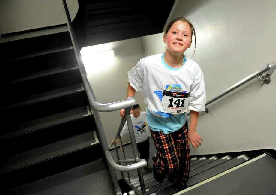 "Rachel Drew, 9, of Delmar nears the top during the ""U Can Do It1"" Climb portion of the annual Corning Tower Stair Climb on Thursday, March 7, 2013, in Albany, N.Y. Her sister, Mollie Drew, 11, is close behind as they made a shorter climb. The event benefits the Cystic Fibrosis Foundation. (Cindy Schultz / Times Union) Photo: Cindy Schultz / 10021215A"
