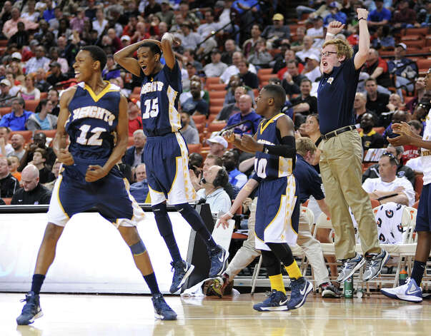 Arlington Heights cheers after a comeback over Terry during the UIL 4A state semifinal boys basketball game between Rosenburg Terry and Fort Worth Arlington Heights high schools on Thurs., March 7, 2013 at the Frank Erwin Center in Austin, TX. Photo: Ashley Landis / copyright 2012 Ashley Landis