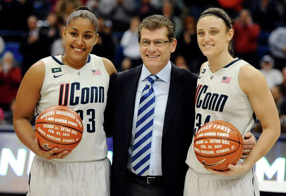 Connecticut head coach Geno Auriemma, center stands with players Kaleena Mosqueda-Lewis, left, and Kelly Faris as they are honored for both reaching the 1,000 career point mark before an NCAA college basketball game against Pittsburgh in Hartford, Conn., Tuesday, Feb. 26, 2013. (AP Photo/Jessica Hill) Photo: Jessica Hill, Associated Press / FR125654 AP
