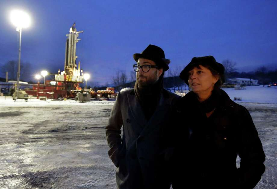 FILE - In this Jan. 17, 2013 file photo, Sean Lennon and actress Susan Sarandon visit a fracking site in New Milford, Pa. As thousands around the country mobilize for and against hydraulic fracturing, industry and some environmental groups in Illinois have come together to draft regulations both sides could live with. Some hope that cooperative approach could be a model for other states. (AP Photo/Richard Drew, File) Photo: Richard Drew