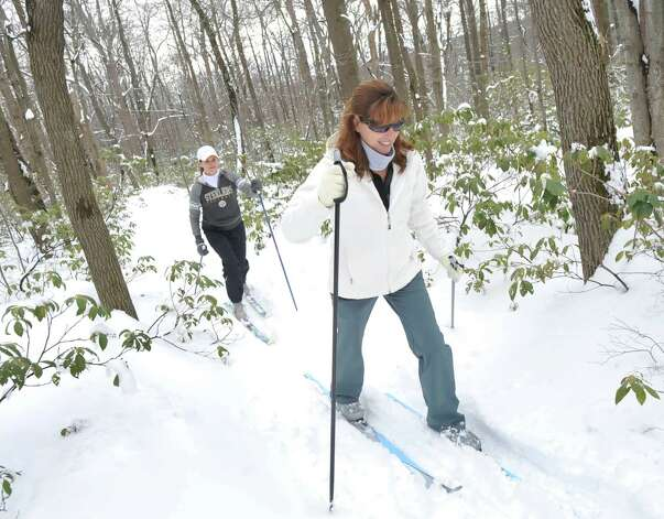 Amy Price, of Jennerstown, right, and her friend, Theresa Pelesky, of Boswell cross country ski in Laurel Mountain State Park near Jennerstown, Pa.. They are pre-school teachers whose school was closed for the day due to the weather. Jenner Township received six to eight inches of snow from the storm. (AP Photo/The Tribune-Democrat, John Rucosky) THE MORNING CALL OUT; DAILY AMERICAN OUT; WJAC-TV OUT Photo: John Rucosky